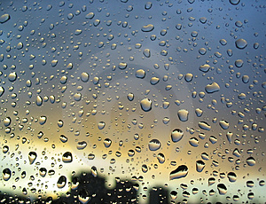 Rain-drops-on-the-window-sunset-in-background-stormy-clouds-behind-3-thumb212200